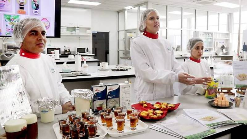 Fonterra innovation in the laboratory - from left; Hemang Bhatt, Donna McBride and Leena Kishor explain the research and development behind products developed for the Chinese market, including tea macchiato, ambient cream, egg tarts and cream cheese lollipops.