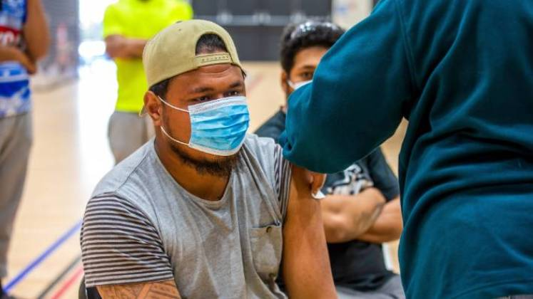 Thornhill RSE worker Pesamino Aobatia gets the Covid jab. The Government is letting in vaccinated seasonal workers from the Pacific Islands quarantine free to support the horticulture sector.