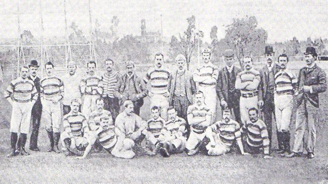 1888 British Lions rugby tourists in Melbourne. Photograph taken on the Scotch Oval; note tower of Government House in central distance.