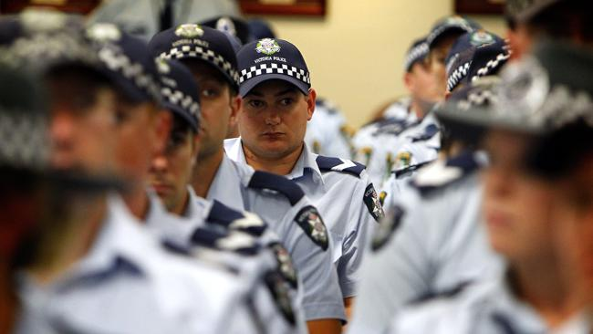 New recruits are sworn in to the police force.