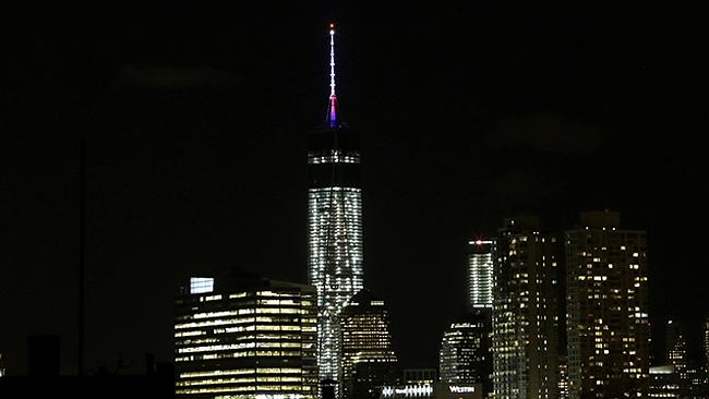 The beacon and spire of One World Trade Center are lit up in New York. Picture: AP