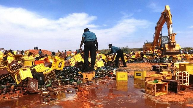 River of beer ... The clean-up would take a while. Pic: Aminu Abubakar.