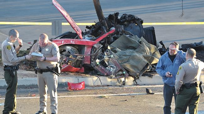 Police at the scene of the horrific crash near Kelly Johnson Parkway in Valencia that killed actor Paul Walker.