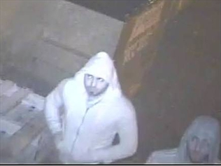 A CCTV image of two people who may have answers into a fatal shooting