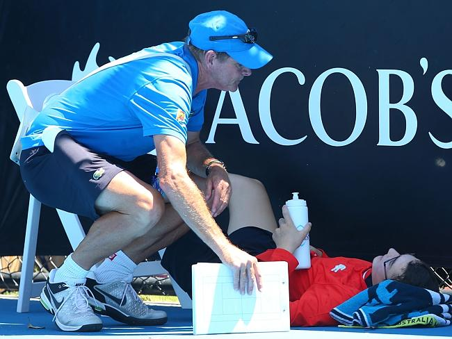 A ballboy faints in the heat, as Melbourne heads towards 43 degrees celsius.