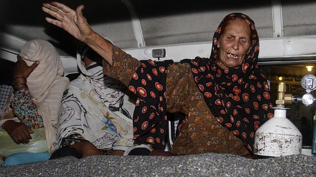 Abduction claims ... a woman wails over the body of her relative Farzana Parveen, who was
