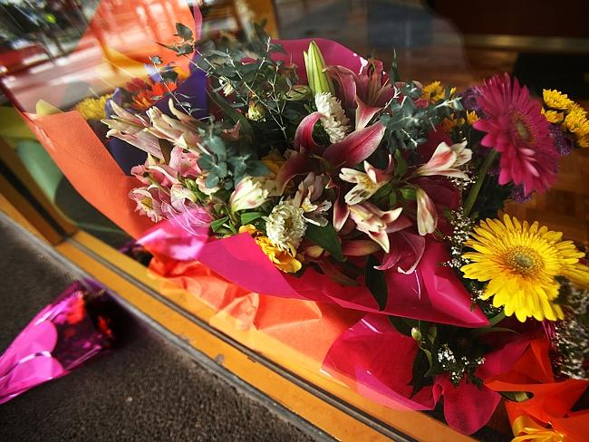 Floral tributes are seen for Sunbury (Victoria) couple Albert Rizk and his wife Marie Riz