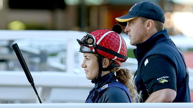 Tegan Harrison with trainer Tony Gollan at the Eagle Farm jumpouts on Tuesday. Picture: M