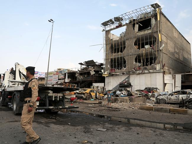 Aftermath ... Security forces inspect the site of a car bomb explosion in the largely Shi