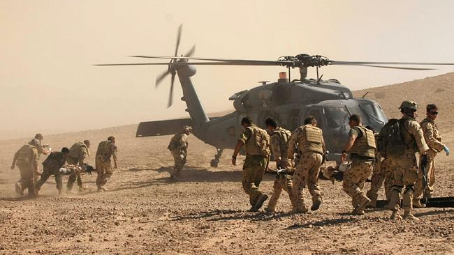 Fight for life ... Australian and Afghan troops race to evacuate the civilian victims of