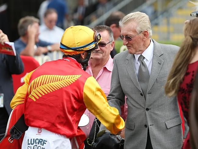 Robbie Fradd and Graeme Boyd shake after Tarloshan saluted at Doomben in December. Pictur