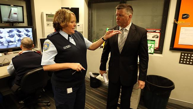 Then Minister for Police and Emergency Service Michael Gallacher is given a tour of the h