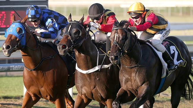 The Doomben 10,000, won last year in a thrilling finish by Spirit Of Boom, right, is amon