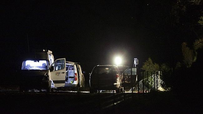 Police and forensic officers process the scene where Ms Scott's body was found. Picture: