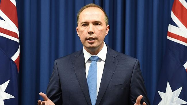 Federal Immigration Minister Peter Dutton had two sneakers thrown at him at an event in B