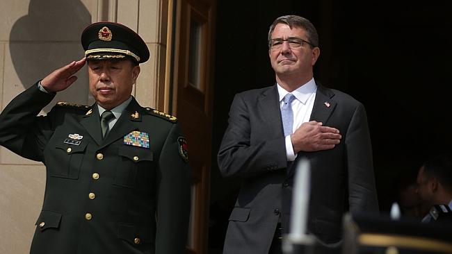China's General Fan Changlong and Secretary of Defense Ashton Carter listen to the US nat