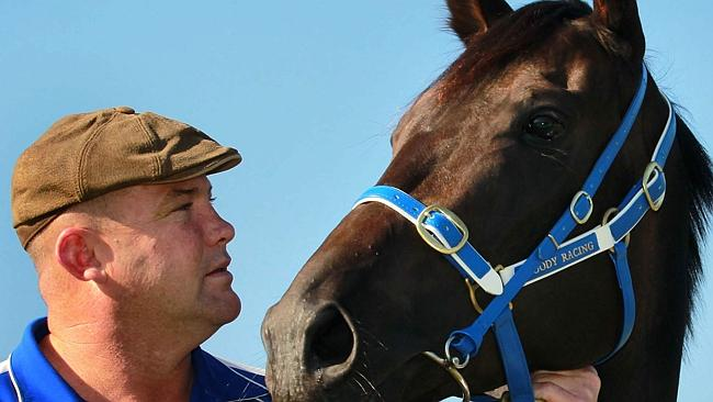 Peter Moody with the legendary Black Caviar. Pic Darren England.