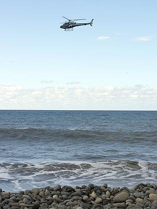 Looking for more ... A French helicopter flies over Reunion Island yesterday.