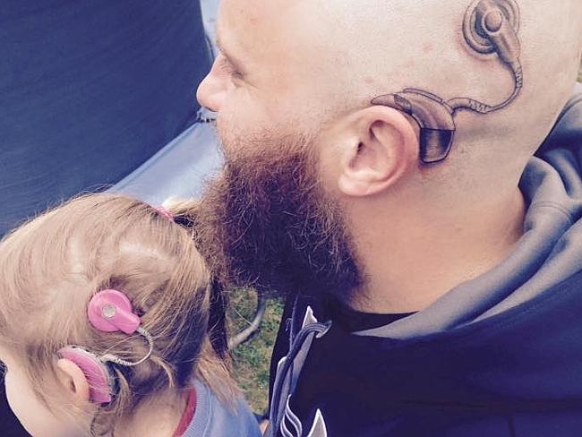 Fatherly love ... Alistair Campbell got a cochlear implant tattoo in support of his heari