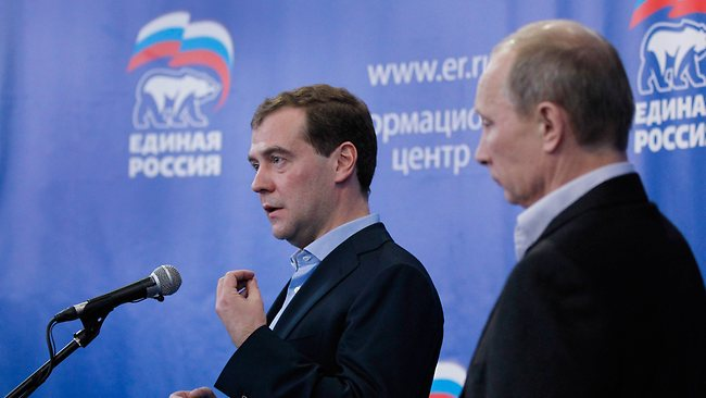 Putin & Medvedev (with the UR logo in the background)