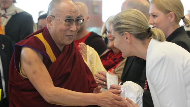 Dalai Lama arrives at the Adelaide Airport, South Australia, greeted by his followers.