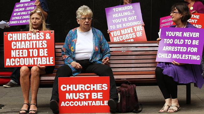 Members of CLAN (Care Leavers of Australia Network) protest outside Governor Macquarie Tower / Picture: Toby Zerna