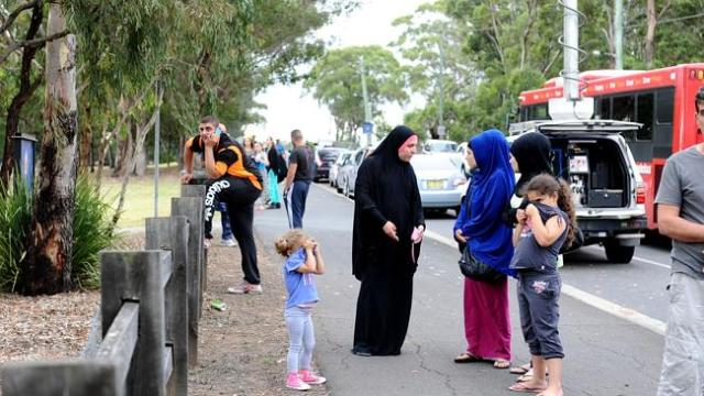 Local residents have gathered at the scene and expressed their disgust and disbelief.