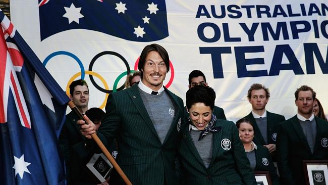 Alex Pullin of Australia is handed the flag by Lydia Lassila after he was announced as the Flag Bearer for Australia at the S...