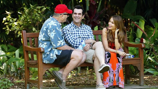 Having a blast ... Ed O'Neill, Ty Burrell and Sofia Vergara have a laugh during a break from filming in Sydney's Botanic Gardens. Picture: Craig Greenhill Source: News Corp Australia