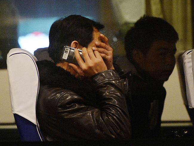 In shock ... relatives of passengers from the missing flight in Beijing.