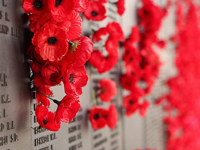 Poppies placed beside the names of the Australian men and women that died during the Seco