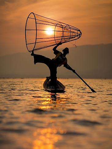 An acrobatic fisherman with a cone net on Inle Lake. Picture: Adam Bennett, Lonely Planet