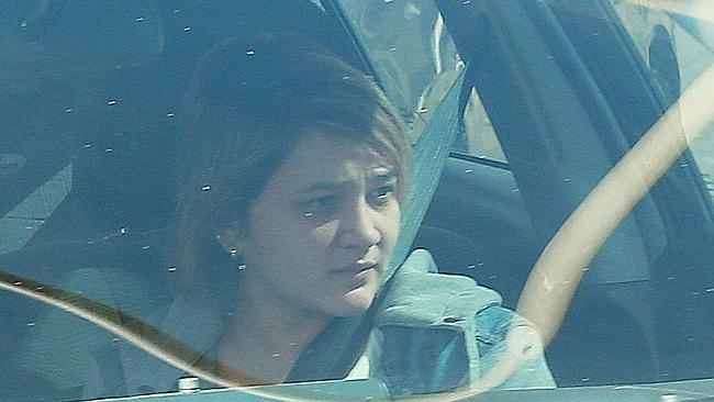 A woman believed to be Warriena Wright's sister, Reza Tagpuno Wright, pictured being driv
