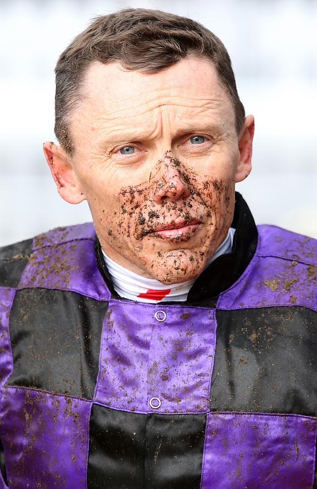 A jockey's life: A very muddy Chris Munce. Picture: Jono Searle
