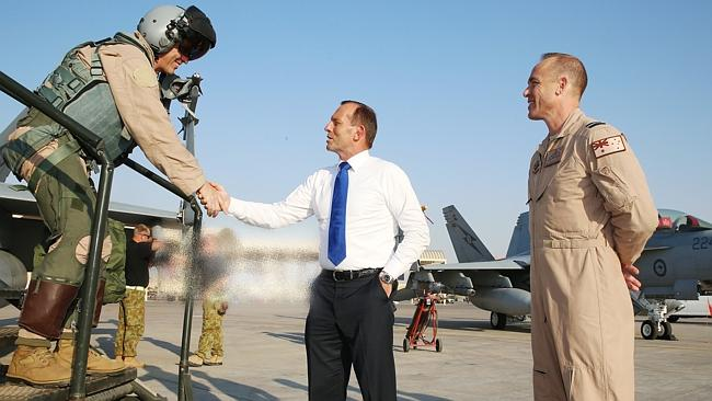 Visit ... Tony Abbott shakes the hand of a FA18 Super Hornet Pilot who had just returned