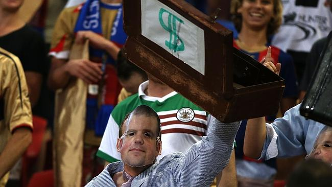 A Jets supporter shows his feelings about owner Nathan Tinkler.