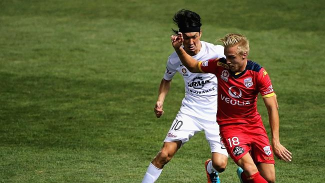 James Jeggo competes for the ball wit Yojiro Takahagi of the Wanderers.