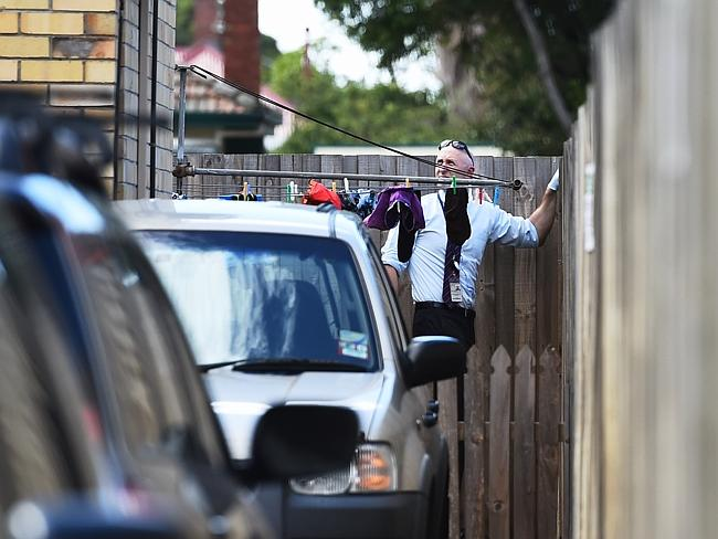 Detectives removed items of clothing from Mr Price's home. Picture: Jake Nowakowski
