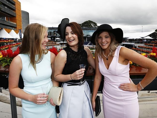 Racegoers Rachel Armstrong, Alise Ferreira and Philippa Alderton enjoy themselves out the
