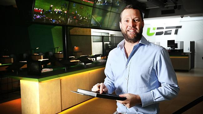 Punter Will Hunter samples the new UBET outlet in New Farm. Picture: Tara Croser