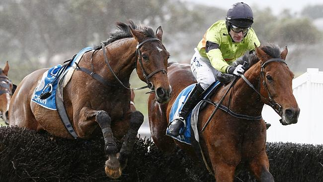Bashboy, ridden by Steven Pateman, jumps the last with a riderless Thubiaan on its way to