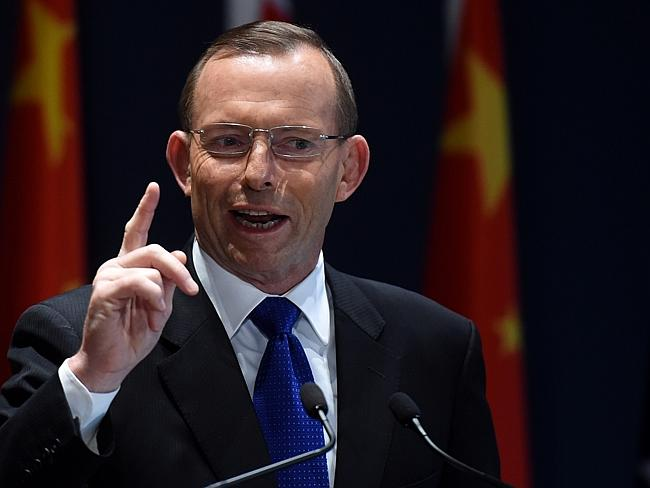 Australian Prime Minister Tony Abbott speaks during the signing ceremony of the deal with