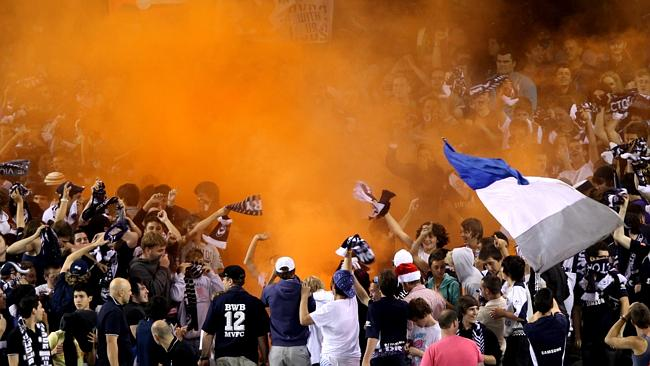 A flare is lit during a Melbourne Victory match.