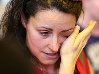 A lady wipes tears from her eyes during a community meeting to advise residents of the fire situation in Perth. Picture: Gett...