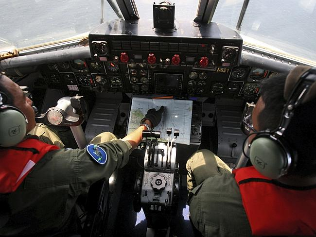 Searching ... Indonesian Navy pilots looking for the missing plane.