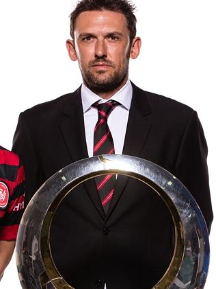 Tony Popovic with the A-League trophy.