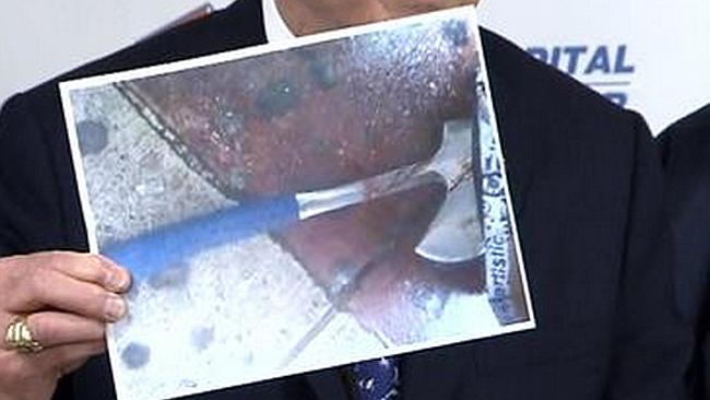 Weapon ... Police Commissioner Bill Bratton holds a picture of the axe used in the attack