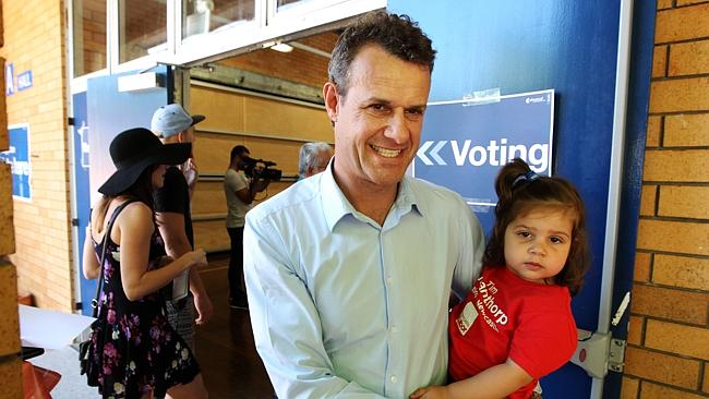 Newcastle Labor candidate and now MP-elect Tim Crakanthorp holds his daughter Avalon afte