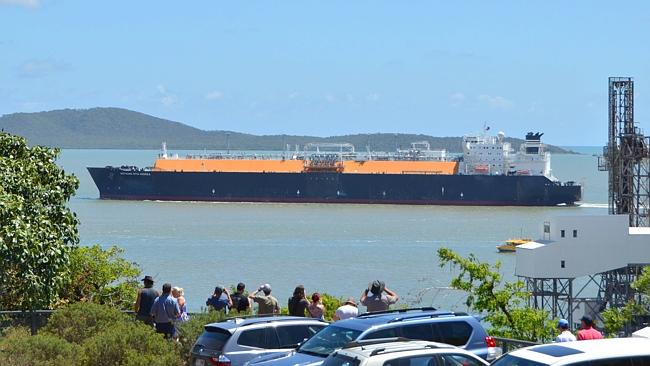 Onlookers watch the Methane Rita Adrea enter Gladstone Harbour on Boxing Day. Picture: Mu