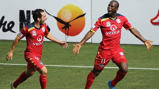 Bruce Djite of United celebrates with fellow goalscorer Sergio Cirio.